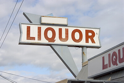 a liquor store sign in the 1950's style.